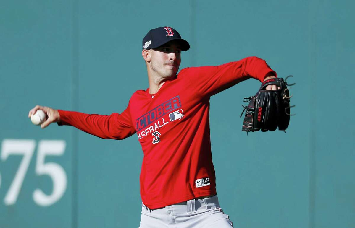Boston Red Sox pitcher Rick Porcello throws during wEDNESDAY'S WORKOUT. The Red Sox take on the Cleveland Indians in Game 1 of baseball's American League Division Series tonight.