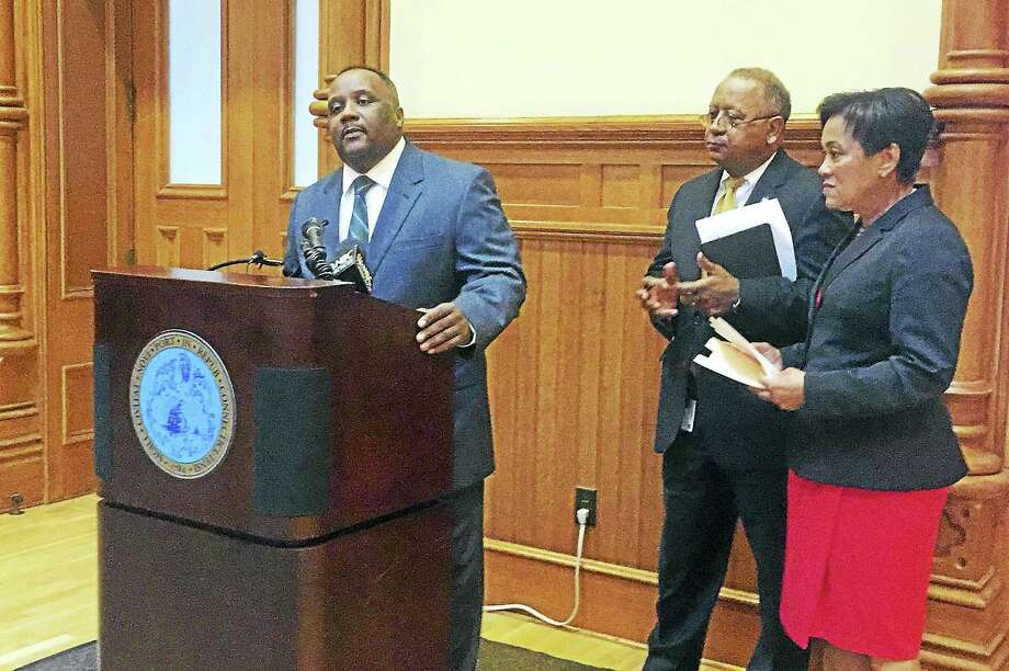 John A. Alston, Jr., left, speaks during a press conference next to New Haven Chief Administrative Officer Michael Carter and Mayor Toni Harp on Sept. 29 at City Hall. Photo: Esteban L. Hernandez — New Haven Register