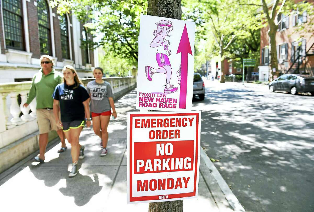 (Arnold Gold-New Haven Register) Signs are posted on Temple St. in New Haven near the start and finish lines of the Faxon Law New Haven Road Race on 9/4/2016.