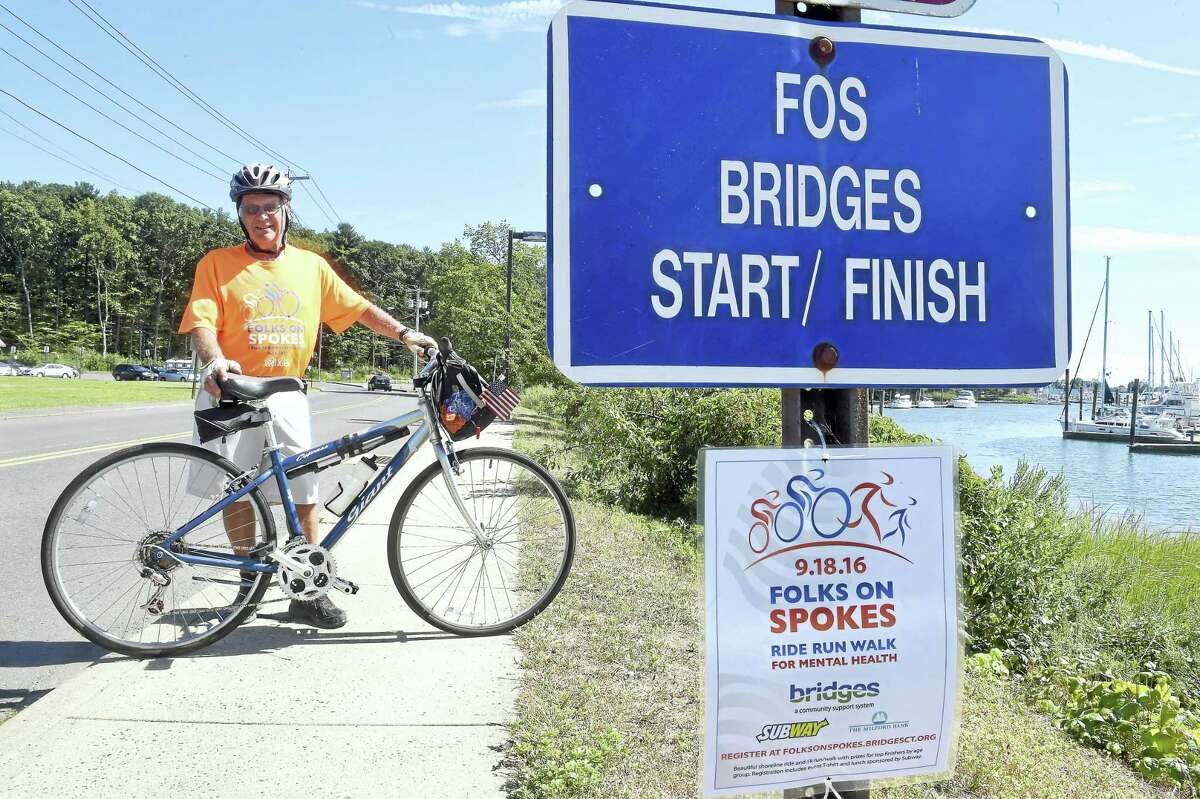 Carlos Smith of Milford with his bicycle where the start/finish line is located for the Folks on Spokes ride in Milford.