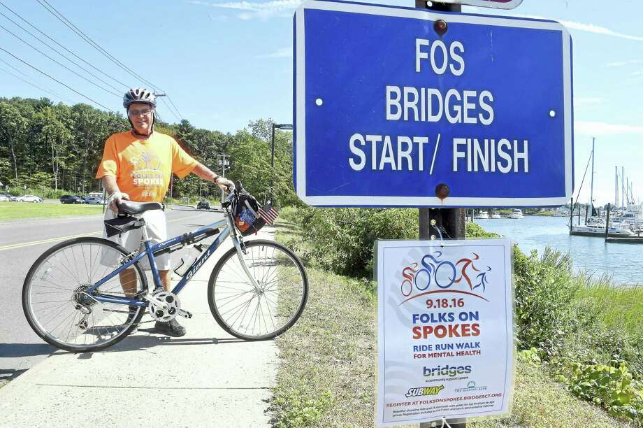 Carlos Smith of Milford with his bicycle where the start/finish line is located for the Folks on Spokes ride in Milford. Photo: Arnold Gold — New Haven Register