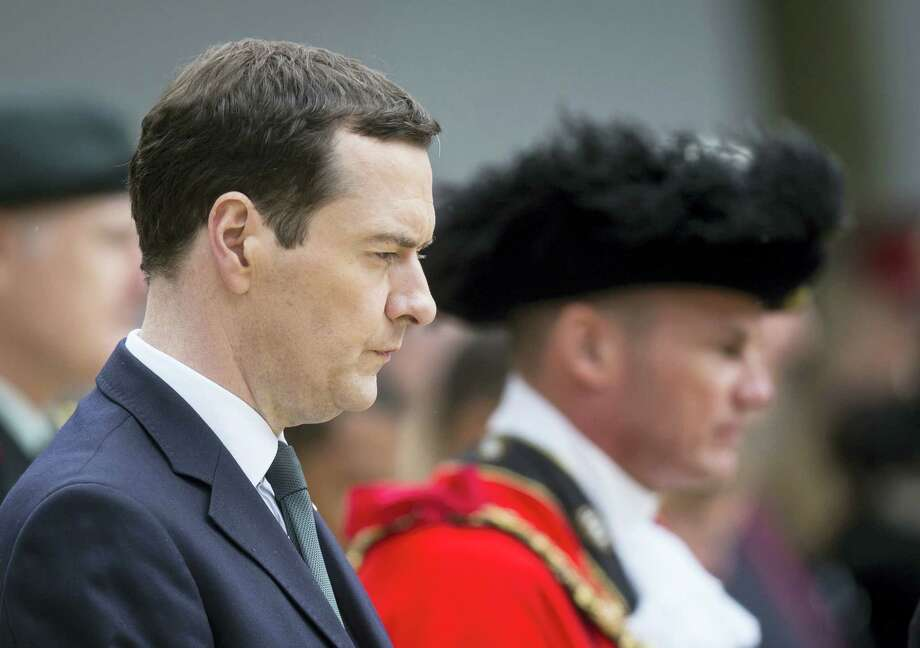 Britain's Chancellor of the Exchequer George Osborne prepares to lay a wealth at the Cenotaph in St Peter's Square, Manchester, England, where a commemoration was held to mark the 100th anniversary of the start of the World War I battle of the Somme on Friday. Photo: Danny Lawson — PA Via AP   / PA
