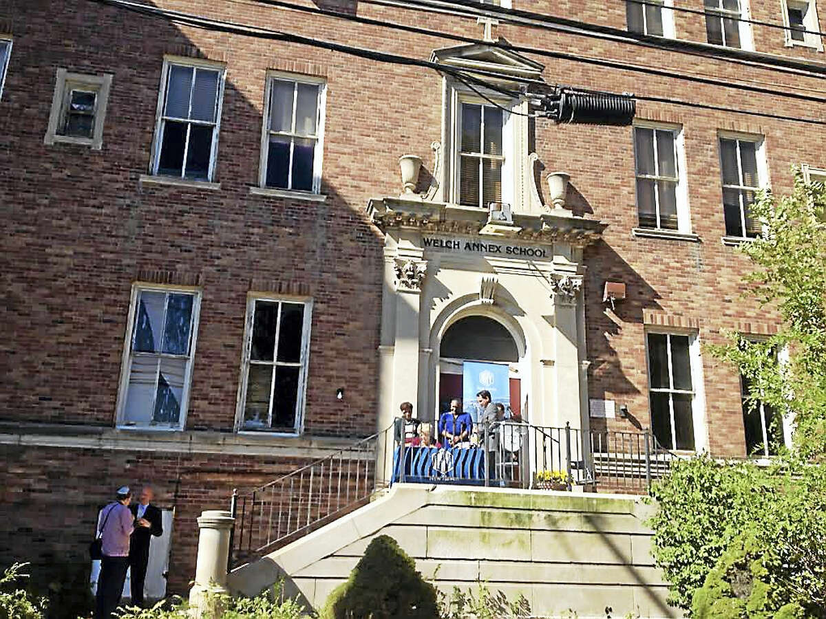 View of the Welch Annex School which will be converted to 100 apartments. Officials signed a development agreement Wednesday.