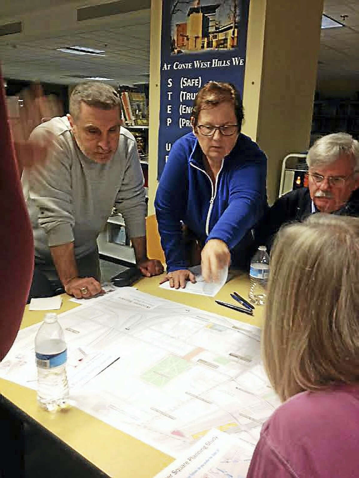 Wooster Square residents Wednesday gather around a map of the area to discuss potential street changes, particularly State Street.