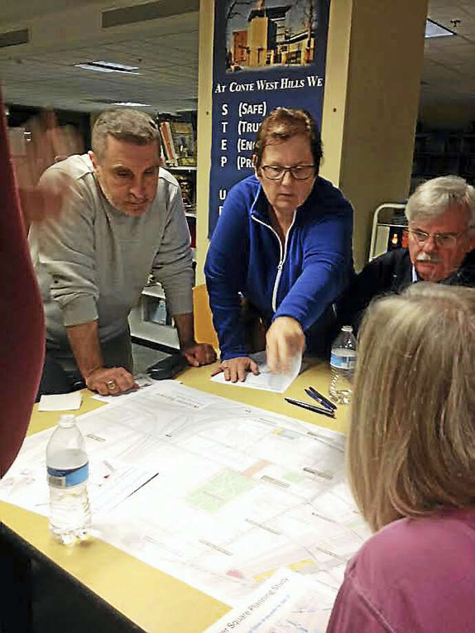 Wooster Square residents Wednesday gather around a map of the area to discuss potential street changes, particularly State Street. Photo: MARY O'LEARY — NEW HAVEN REGISTER