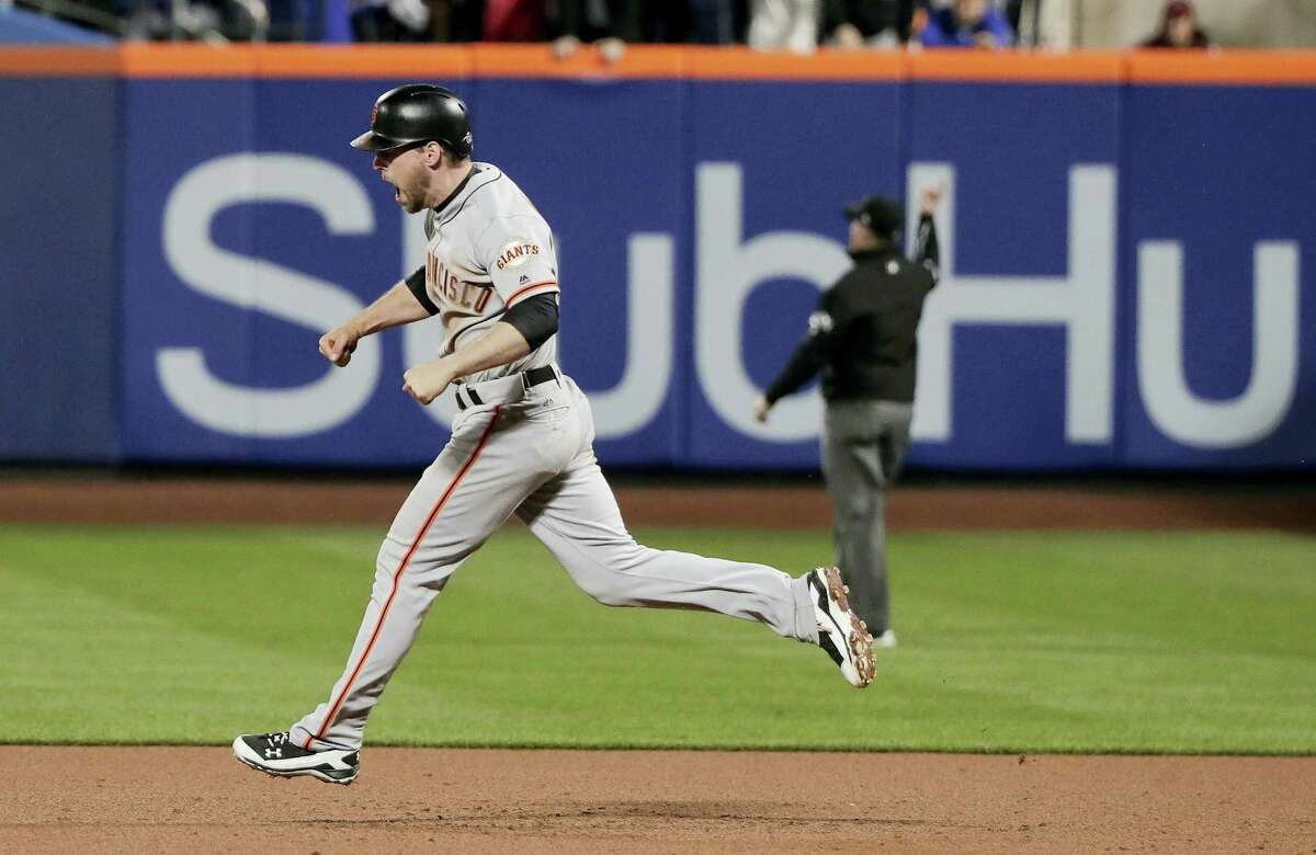 San Francisco'S Conor Gillaspie reacts as he rounds the bases after hitting a three-run home run against the New York Mets during the ninth inning of the National League wildcard baseball game Wednesday in New York. (AP Photo/Julie Jacobson)