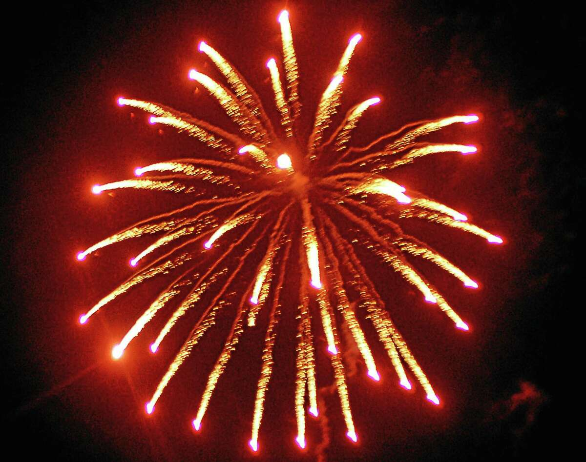 Fireworks burst over Newtown on New Year's Eve.