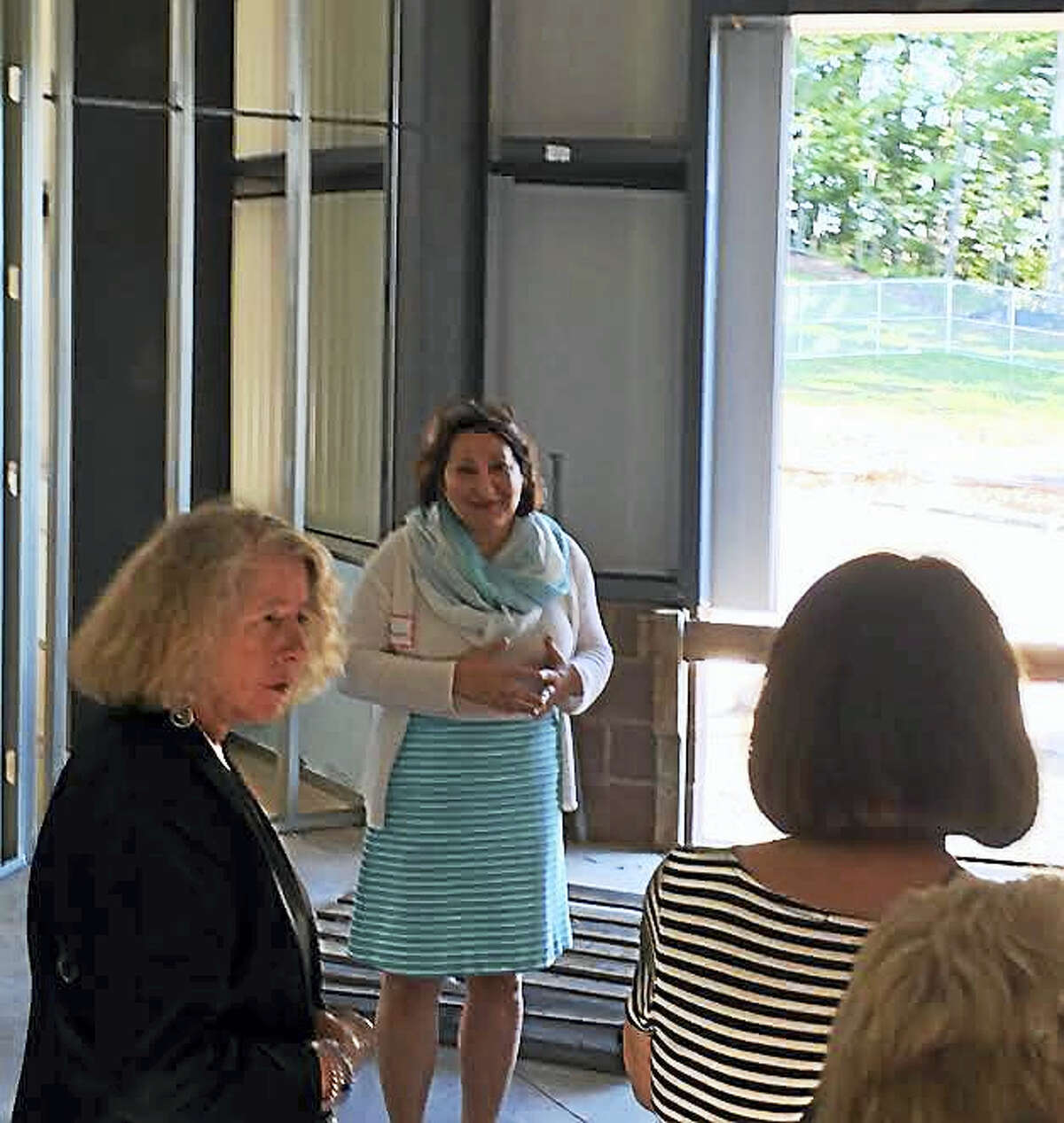 Patty Hartmann, center, executive director of the Cheshire Community Food Pantry, takes a group on a tour of the organization's new home.
