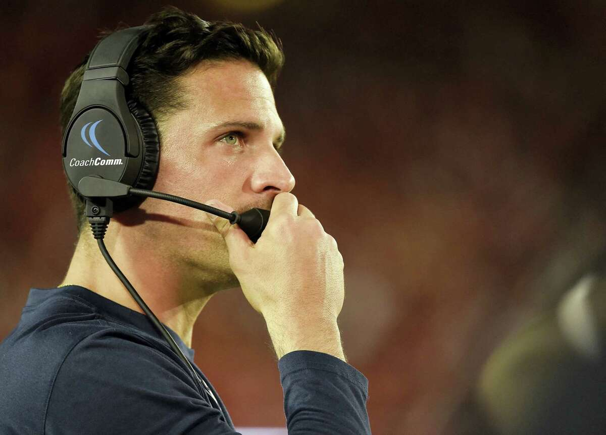 CHRISTIAN SMITH — THE ASSOCIATED PRESS UConn head football coach Bob Diaco watches from the sideline in the second half against Houston. Diaco wants to get Ansonia's Arkeel Newsome many more carries than the six he got against Houston.