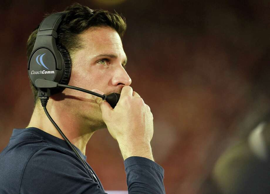 CHRISTIAN SMITH — THE ASSOCIATED PRESS  UConn head football coach Bob Diaco watches from the sideline in the second half against Houston. Diaco wants to get Ansonia's Arkeel Newsome many more carries than the six he got against Houston. Photo: AP / FR171023 AP