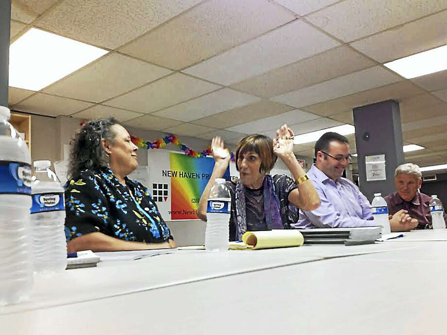 U.S. Rep. Rosa DeLauro, D-3, speaks with Robin McHaelen, executive director of True Colors Sexual Minority and Family Services, at a round-table discussion Thursday with Greater New Haven LGBTQ leaders and activists. Photo: MARK ZARETSKY — NEW HAVEN REGISTER