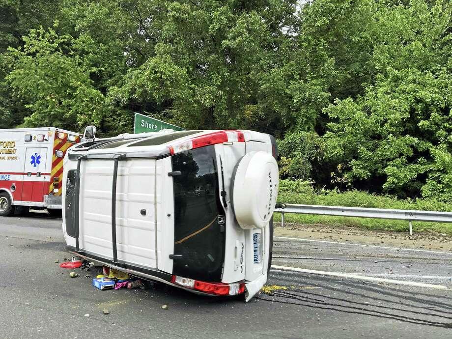 Honda CRV on its side after crash Photo: Kathleen Schassler — New Haven Register