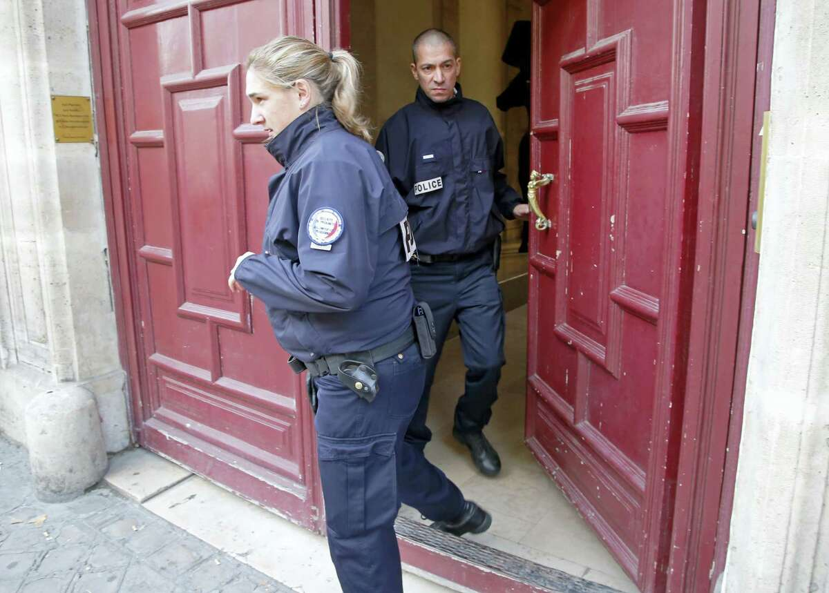 French police officers exit the residence of Kim Kardashian West in Paris Monday, Oct. 3, 2016. Kim Kardashian West was unharmed after being robbed at gunpoint of more than $10 million worth of jewelry inside a private Paris residence Sunday night, police officials said.