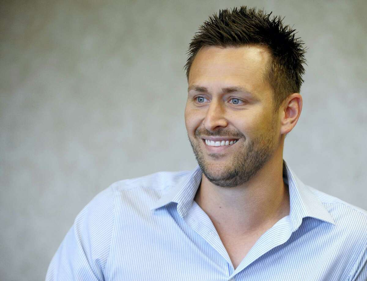 In a photo, Eric Hagen, CEO of Monarch America, talks about marijuana in Sioux Falls, S.D.