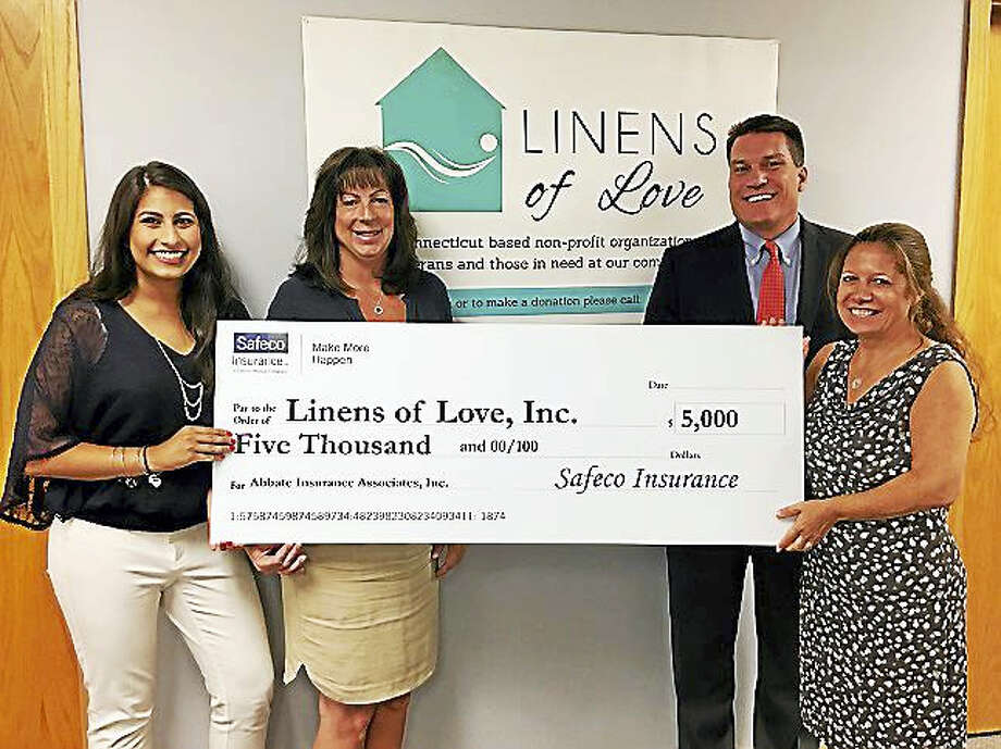 From left, Huda Khalid, director of technology and marketing, Abbate Insurance Associates Inc.; Kathy F. Marinaccio, director, Linens of Love; Mary B. Pursell, owner, Abbate Insurance Associates Inc. and founder of Linens of Love; and James Waldron, territory manager for Safeco Insurance. Photo: CONTRIBUTED PHOTO