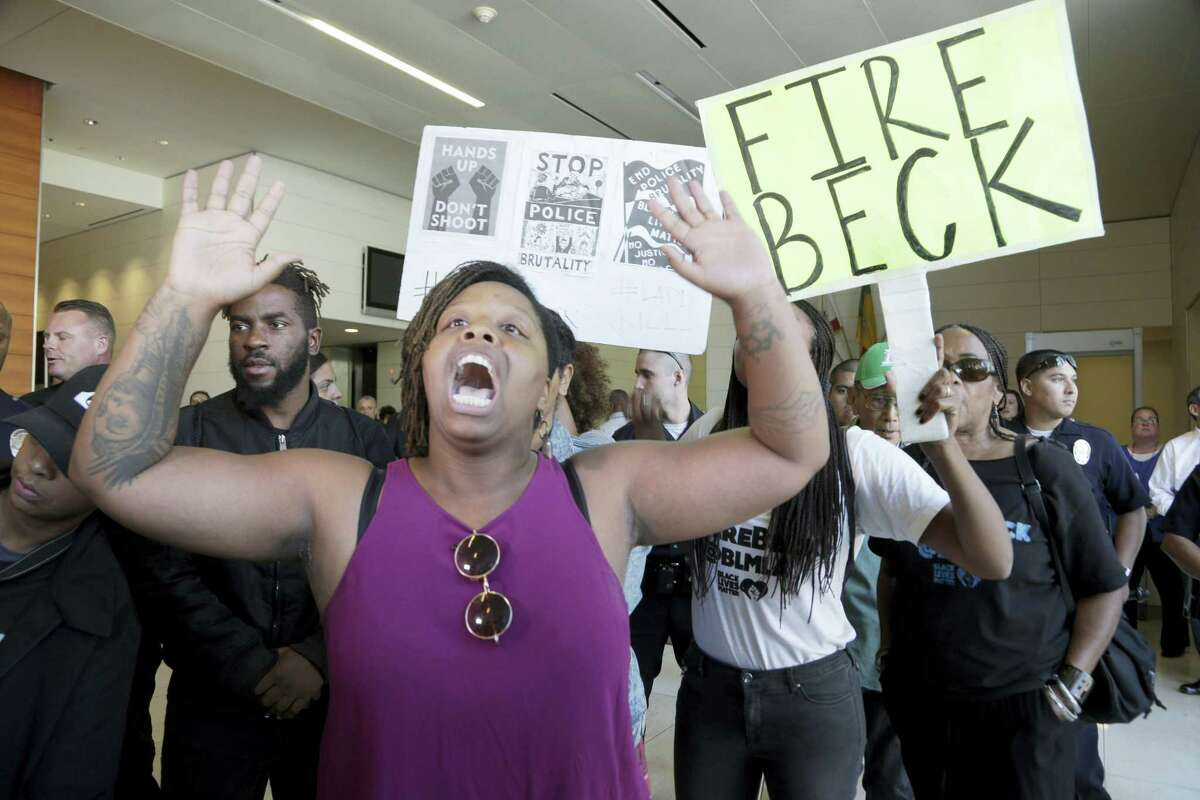 Protesters demand the firing of Los Angeles Police Chief Charlie Beck over a police-involved shooting of a black man over the weekend during a news conference at LAPD headquarters on Oct. 3, 2016. The chief disclosed details of Saturday's shooting of Carnell Snell, in South Los Angeles and a separate fatal police shooting of a Hispanic man Sunday amid heightened tensions over police shootings involving blacks and other minorities in California and elsewhere.