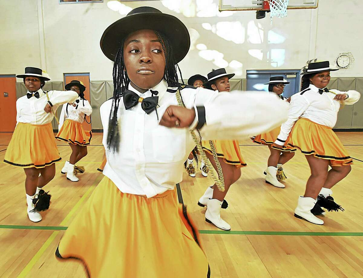 Geornai Cunningham, 13, leads the junior squad of the New Haven Stylettes Drill Team and Drum Corp, in a drill under the direction of Dominick Benjamin in the gymnasium, Thursday, September 1, 2016, at the L.W. Beecher Museum Magnet School after their team placed second in the Elks Grand Lodge World National Competition in New Orleans on August 16, 2016.