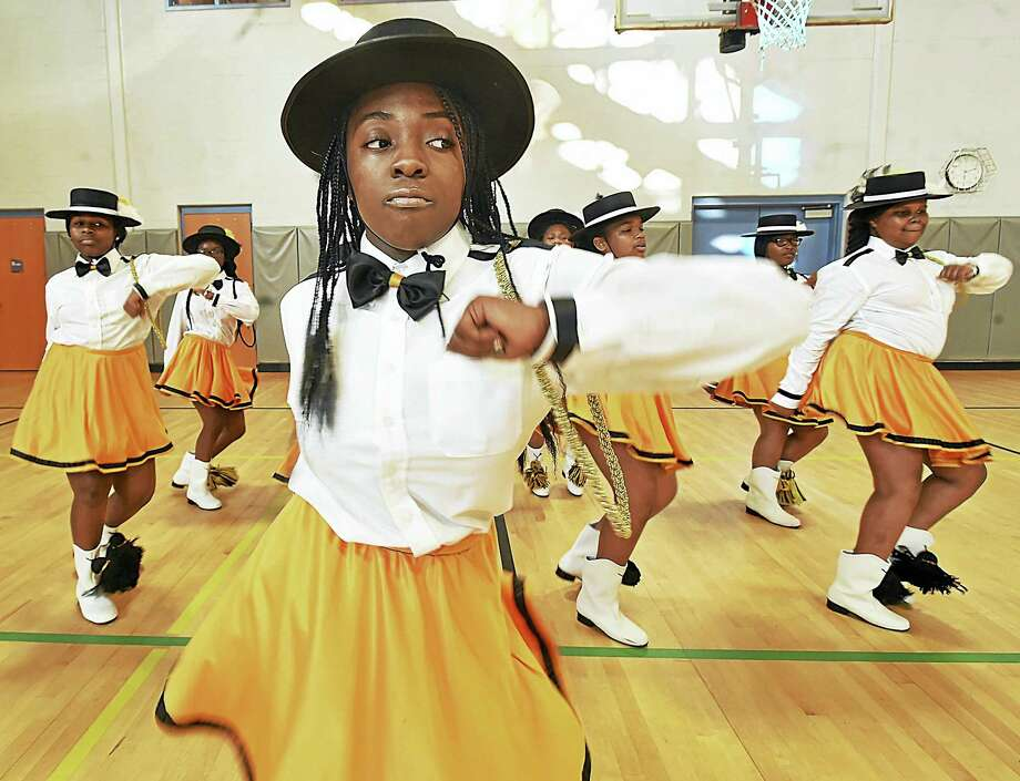 Geornai Cunningham, 13, leads the junior squad of the New Haven Stylettes Drill Team and Drum Corp, in a drill under the direction of Dominick Benjamin in the gymnasium, Thursday, September 1, 2016, at the L.W. Beecher Museum Magnet School after their team placed second in the Elks Grand Lodge World National Competition in New Orleans on August 16, 2016. Photo: Catherine Avalone — New Haven Register / New Haven RegisterThe Middletown Press