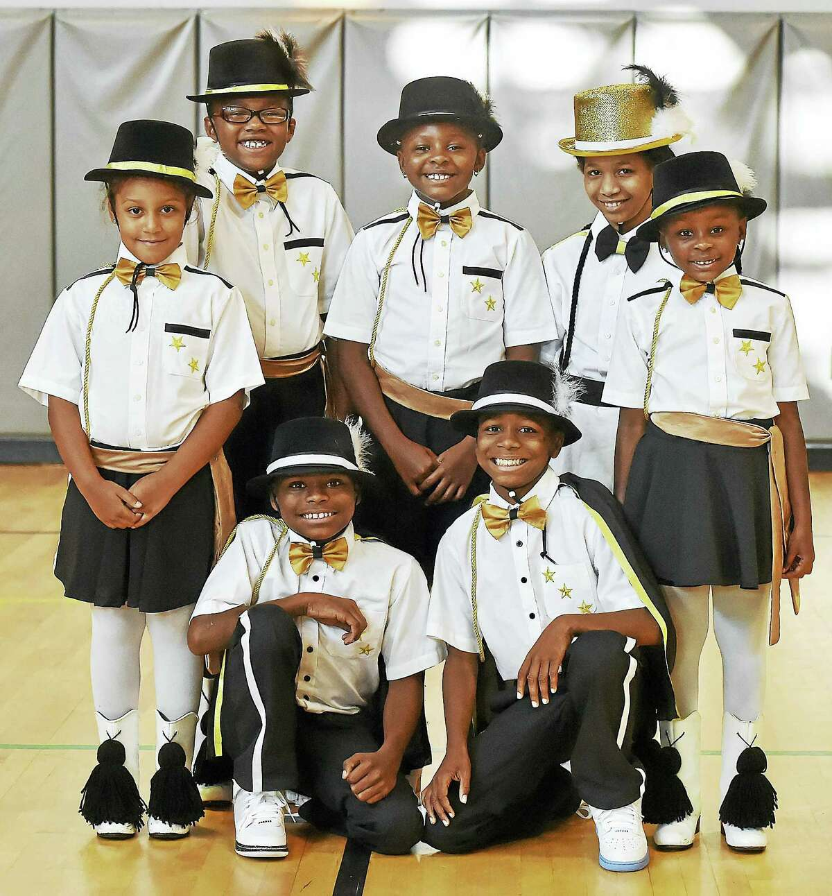 Members of the New Haven Stylettes Midget Drill Team & Drum Corp, Omarion Herbert, 11, Damarion Herbert, 11, front row, left to right, and Leilani Buser, 8, Khaylese Random, 9, Jada Morant, 8, Sanai Berrios, 10, and Jalin Morant, 5, back row, left to right, gathered Thursday, September 1, 2016, at the L.W. Beecher Museum Magnet School for a photograph after placing first in the midget division on August 16, 2016 at the Elks Grand Lodge World National Competition in New Orleans, Louisiana. The Midget Stylettes are under the direction of Latasha Royal.