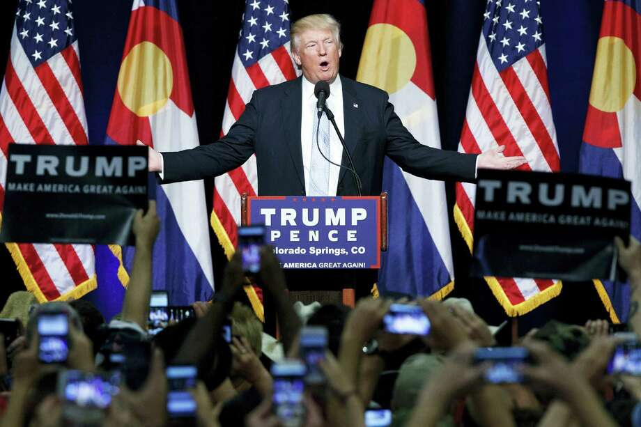 In this Friday, July 29, 2016, file photo, Republican presidential candidate Donald Trump speaks during a campaign rally in Colorado Springs, Colo. Trump broke a major American political and societal taboo over the weekend when he engaged in an emotionally charged feud with Khizr and Ghazala Khan, the bereaved parents of a decorated Muslim Army captain killed by a suicide bomber in Iraq. He further stoked outrage by implying Ghazala Khan did not speak while standing alongside her husband at last week's Democratic convention because they are Muslim. Photo: AP Photo/Evan Vucci, File    / Copyright 2016 The Associated Press. All rights reserved. This material may not be published, broadcast, rewritten or redistribu