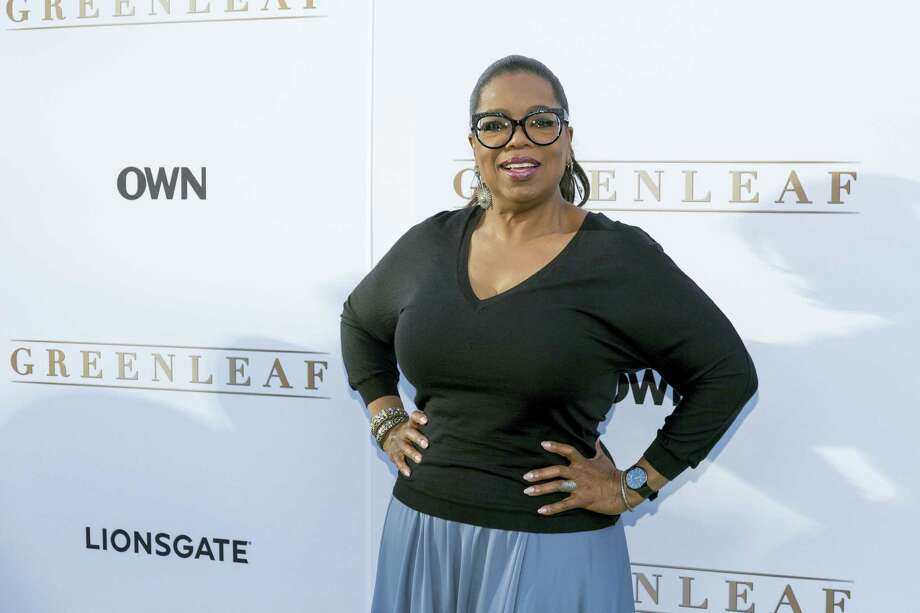 """In this June 15, 2016 photo, Oprah Winfrey arrives at the season one premiere of """"Greenleaf"""" at The Lot in West Hollywood, Calif. Winfrey has a new book club pick, Colson Whitehead's """"The Underground Railroad,"""" a historical novel that imagines the network of safe houses and passages that helped slaves escape to free territory is an actual train. Photo: Photo By Willy Sanjuan/Invision/AP, File   / Invision"""