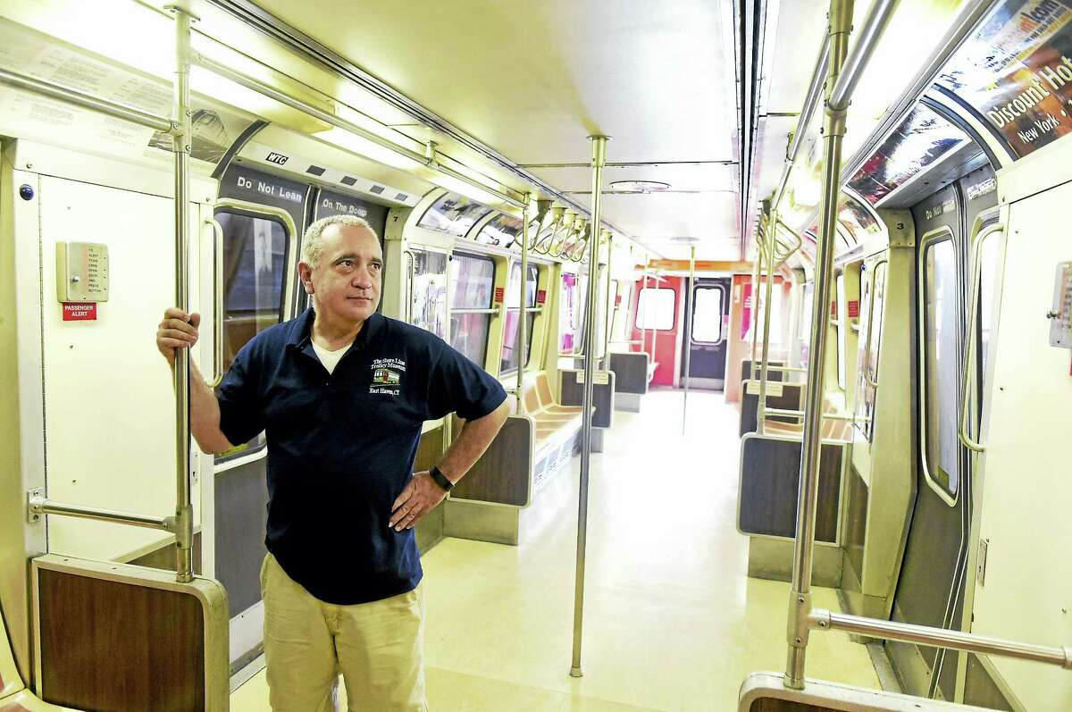 John Proto, executive director of the Shore Line Trolley Museum, stands in the restored PATH Car 745 at the museum in East Haven. The car was found in the PATH subway station under the North Tower of the World Trade Center after it survived the 9/11 terrorist attack. See more photos at: photos.newhavenregister.com.
