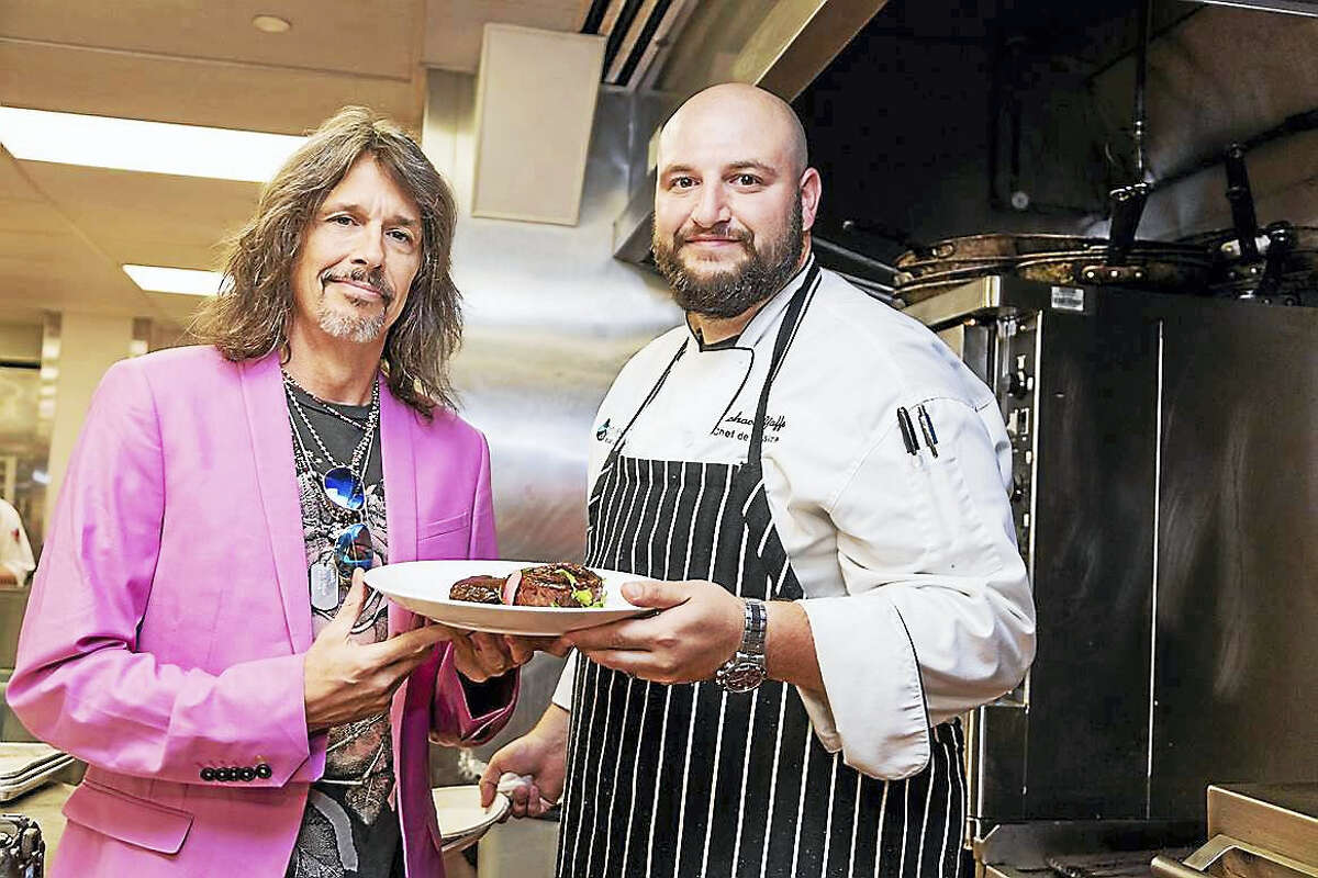 Kelly Hansen, left, with Vue 24 Chef de Cuisine Michael Yaffe, formerly of the Eiffel Tower Restaurant in Las Vegas.
