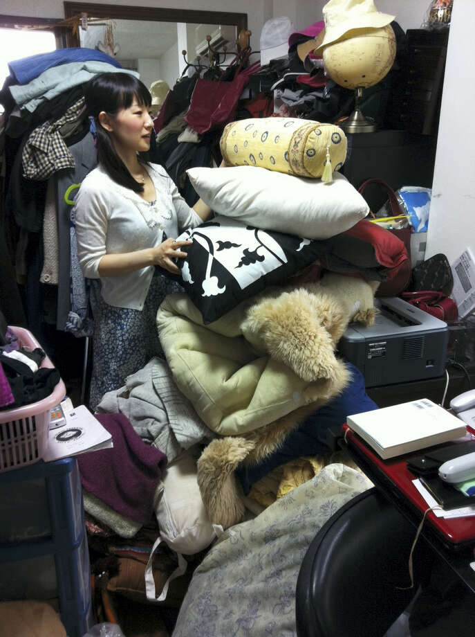 """This undated photo provided by Ten Speed Press shows Marie Kondo working at a client's home to clear away everything that is unneeded in Tokyo, Japan. Kondo is the author of the book, """"The Life-Changing Magic of Tidying Up."""" Photo: AP Photo/Ten Speed Press   / Ten Speed Press"""
