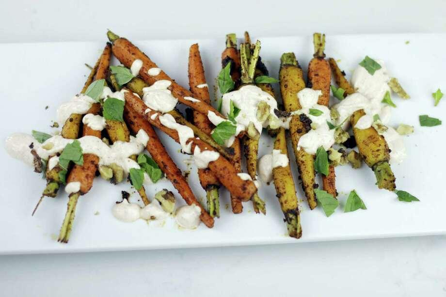 Moroccan spiced carrots with yogurt sauce. Photo: Melissa D'Arabian Via AP   / Melissa d'Arabian