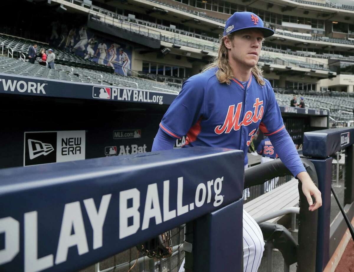 New York Mets starting pitcher Noah Syndergaard steps onto the field for a team workout Tuesday at Citi Field.