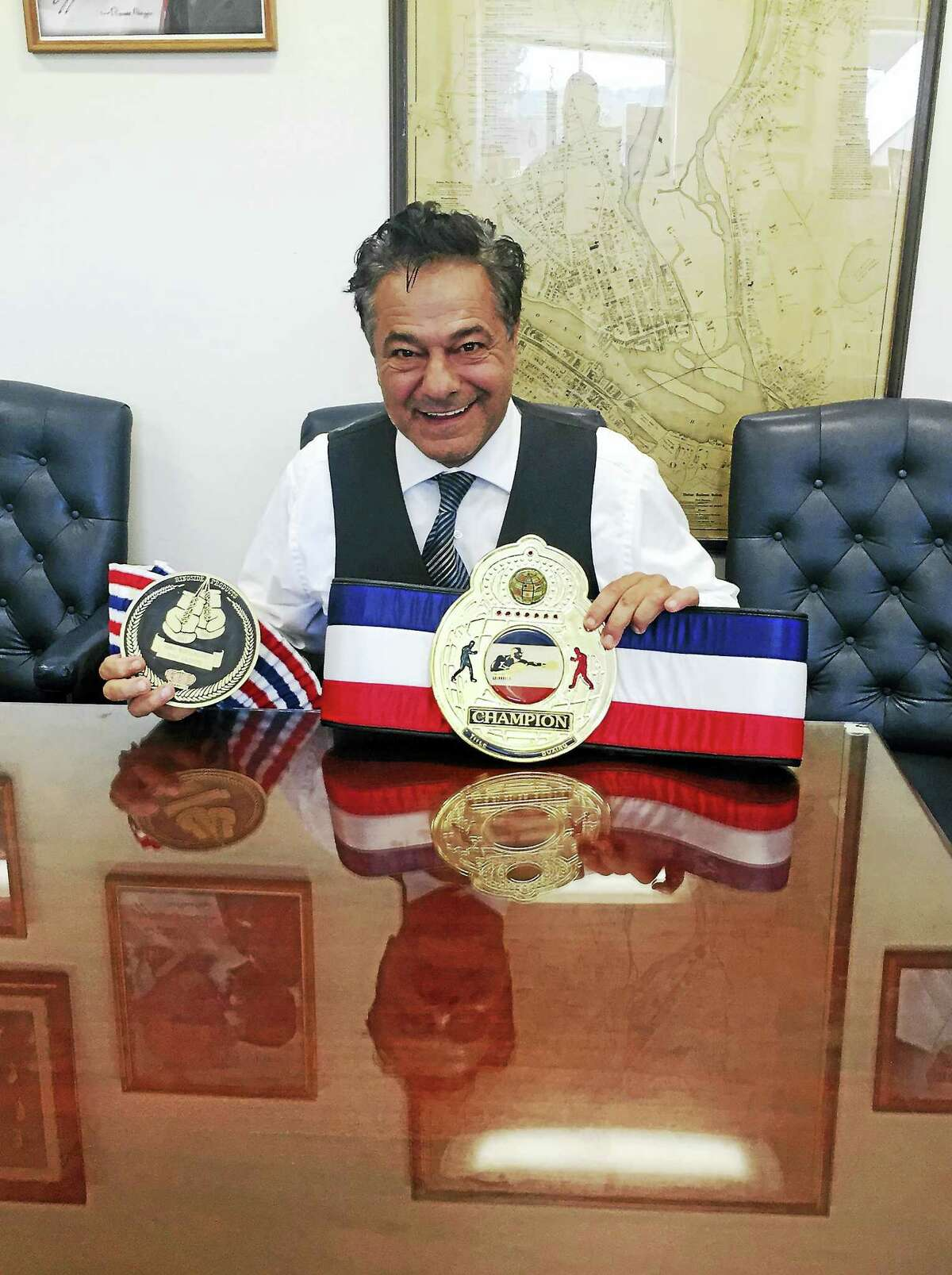 Mayor David Cassetti shows off the belts he earned during his boxing career.