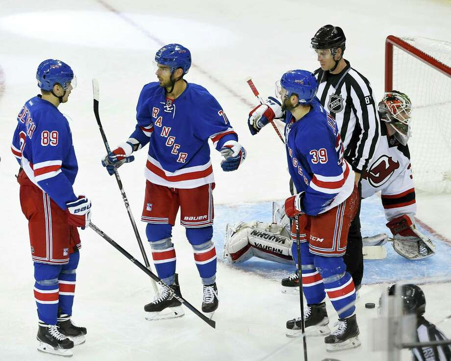 Rangers right wing Pavel Buchnevich (89), right wing Brandon Pirri (73) and right wing Nicklas Jensen (39) celebrate Pirri's goal during a preseason game against the Devils. Photo: Kathy Kmonicek — The Associated Press   / FR170189 AP