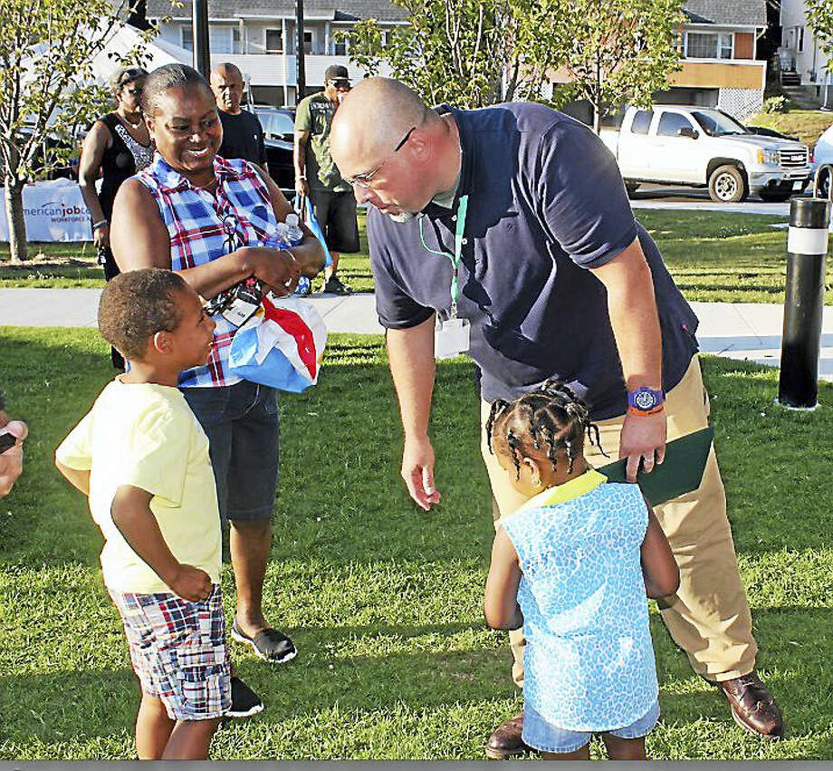 Mayor Curt Balzano Leng talks to kids Tuesday night at National Night Out in Hamden. Photo: KATE RAMUNNI — NEW HAVEN REGISTER