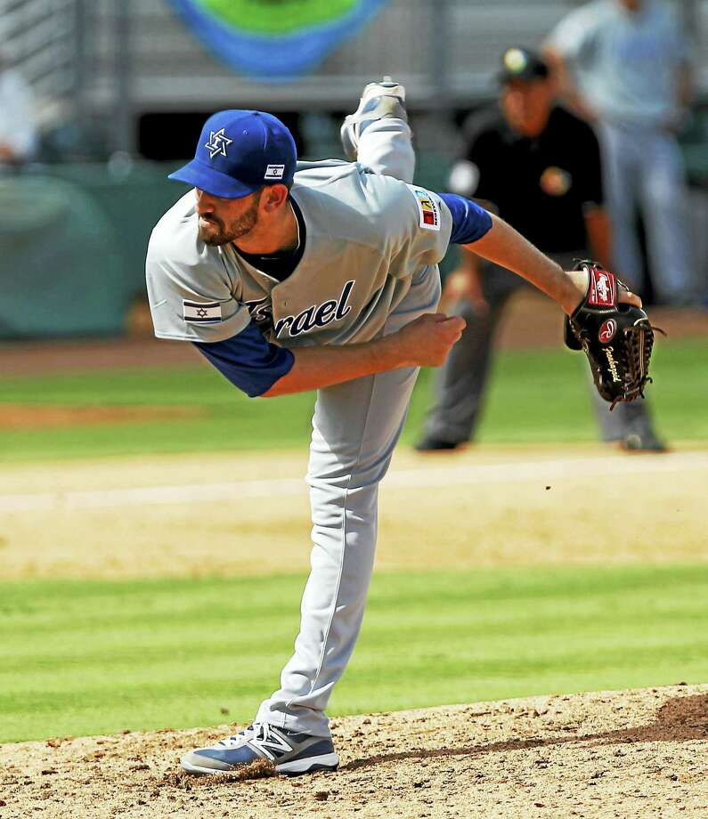 Pitcher Josh Zeid is shown here pitching in a 2012 World Baseball Classic qualifying game. Photo: The Associated Press File Photo   / AP