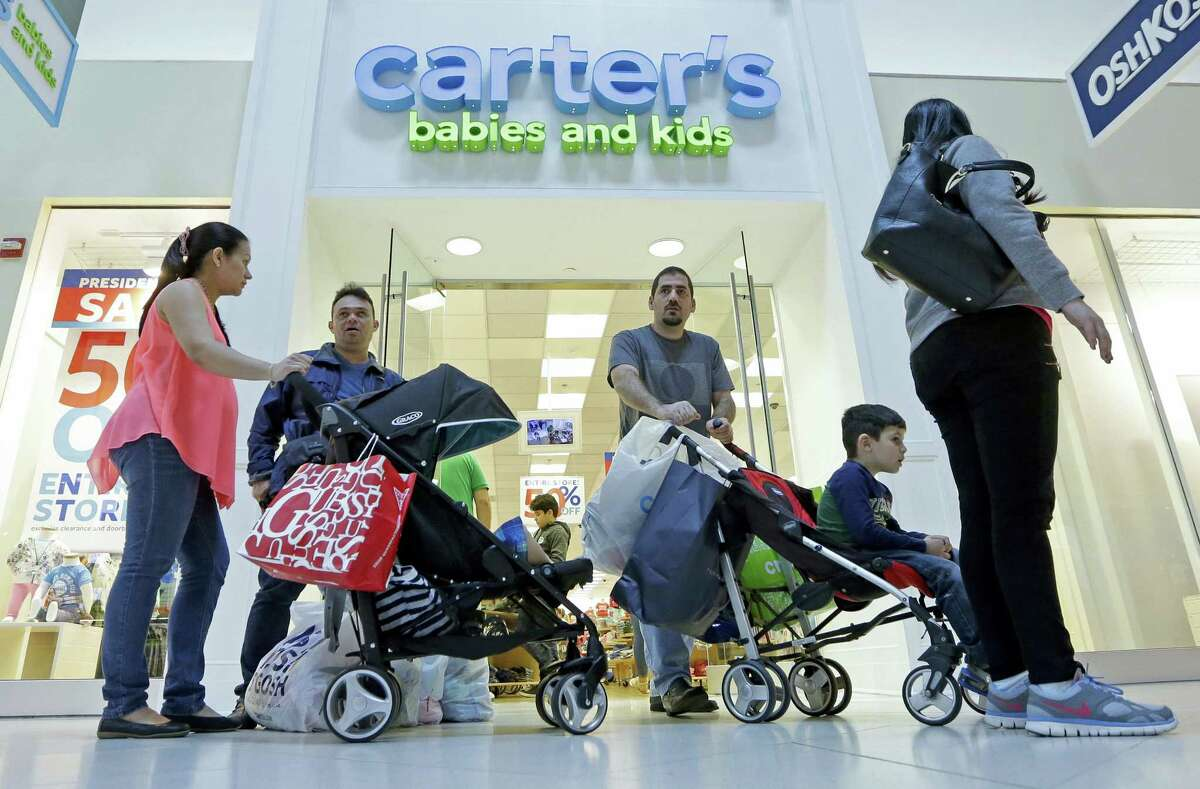 In this Tuesday file photo, shoppers are shown in Miami.