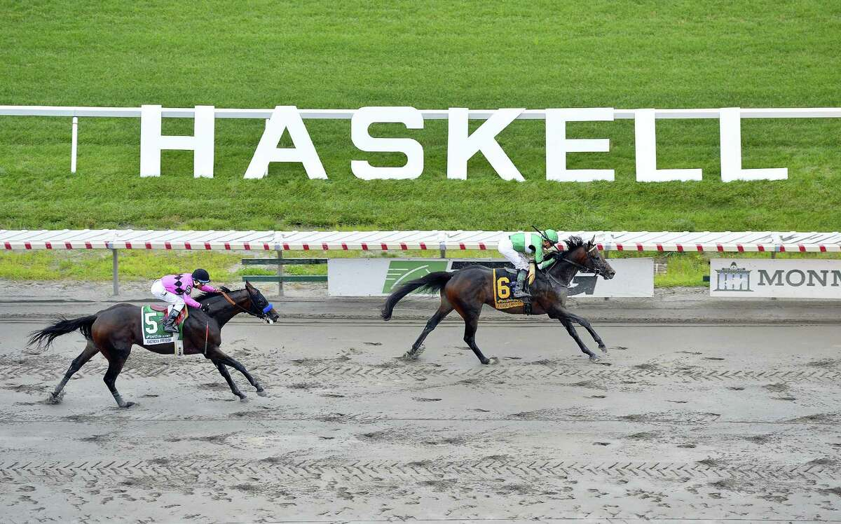 In a photo provided by Equi-Photo, Exaggerator, right, with Kent Desormeaux riding, wins the $1 million Haskell Invitational horse race at Monmouth Park in Oceanport, N.J., on Sunday.
