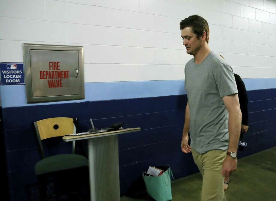 New York Yankees relief pitcher Andrew Miller walks to the clubhouse after being traded to the Cleveland Indians before a baseball game against the Tampa Bay Rays Sunday, July 31, 2016, in St. Petersburg, Fla. (AP Photo/Chris O'Meara) Photo: AP / Copyright 2016 The Associated Press. All rights reserved. This material may not be published, broadcast, rewritten or redistribu