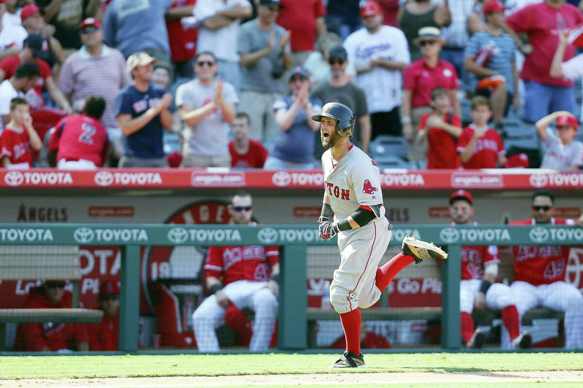 Boston Red Sox second baseman Dustin Pedroia heads to home plate after hitting a three-run home run to put them over the Los Angeles Angels during the ninth inning of a baseball game, Sunday, July 31, 2016, in Anaheim, Calif. (AP Photo/Ryan Kang)