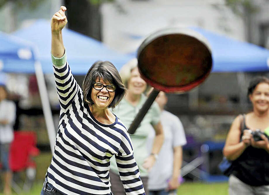 The 105th annual Haddam Neck Fair runs through Sept. 5 on the fairgrounds on Quarry Hill Road in East Hampton. Here, Deb Simpson takes part in a skillet-throwing contest. Photo: Courtesy Haddam Neck Fair Association
