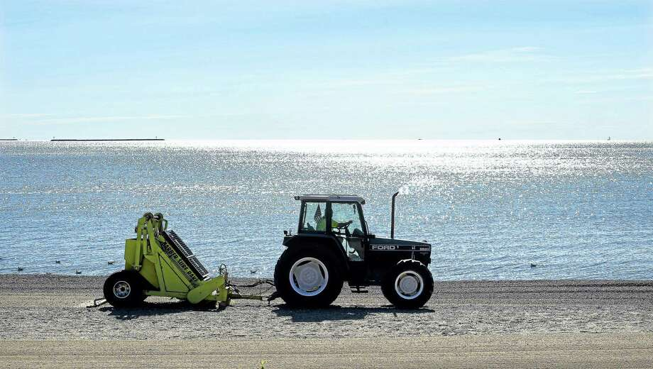 Jim Austin of Milford Public Works rakes the sand near Beach Avenue in Milford Friday morning. The sand at Milford public beaches is raked five days a week from Memorial Day through Labor Day. Photo: Arnold Gold — New Haven Register
