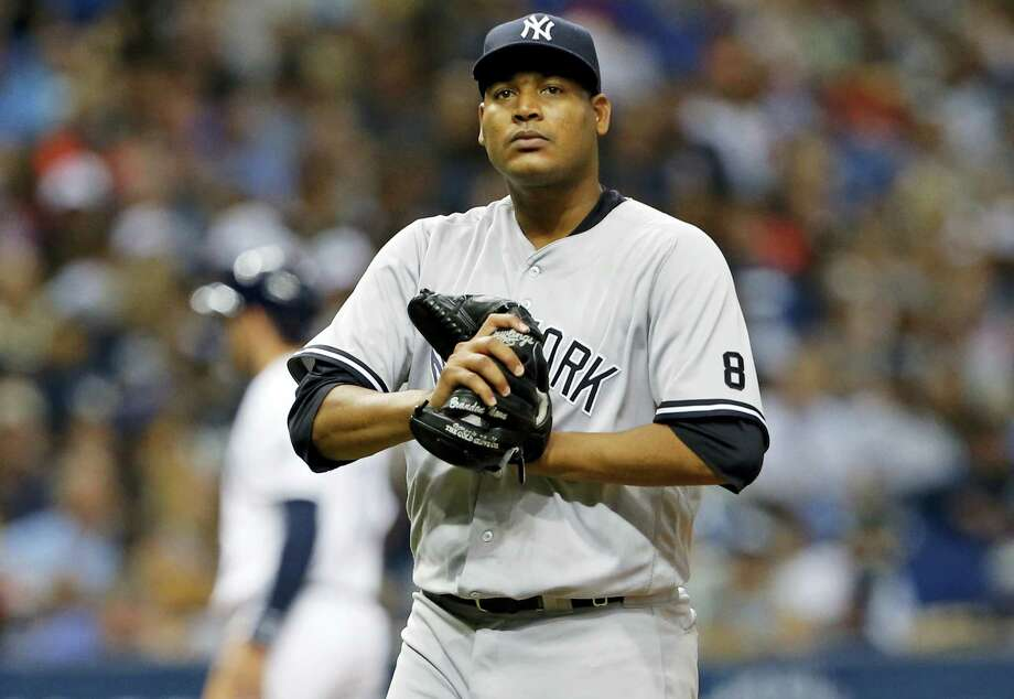 Pitcher Ivan Nova reacts was traded from the New York Yankees to the Pittsburgh Pirates. Photo: Mike Carlson — The Associated Press   / FR155492 AP