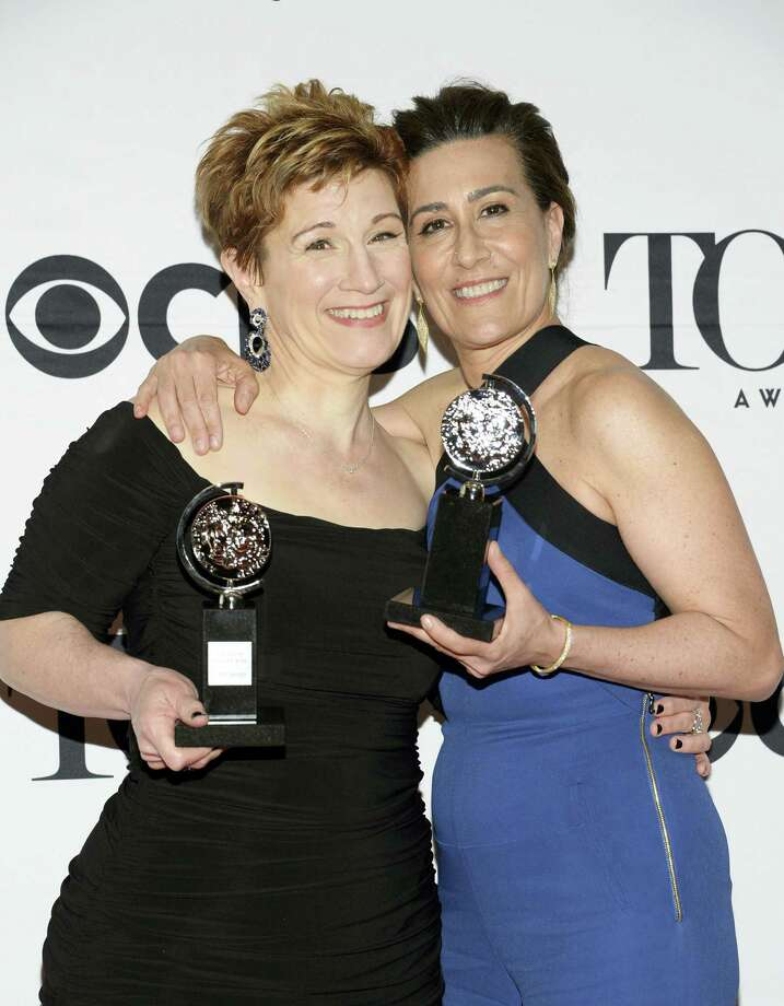 "In this June 7, 2015 photo, Lisa Kron, left, and Jeanine Tesori pose with the award for best score for ""Fun Home"" in the press room at the 69th annual Tony Awards in New York. ""Fun Home,"" the 2015 Tony-winning best musical, has begun its national tour as the first Broadway show with a lesbian protagonist, one who is dealing with a parent's suicide and her own sexuality. Photo: Photo By Evan Agostini/Invision/AP, File   / Invision"