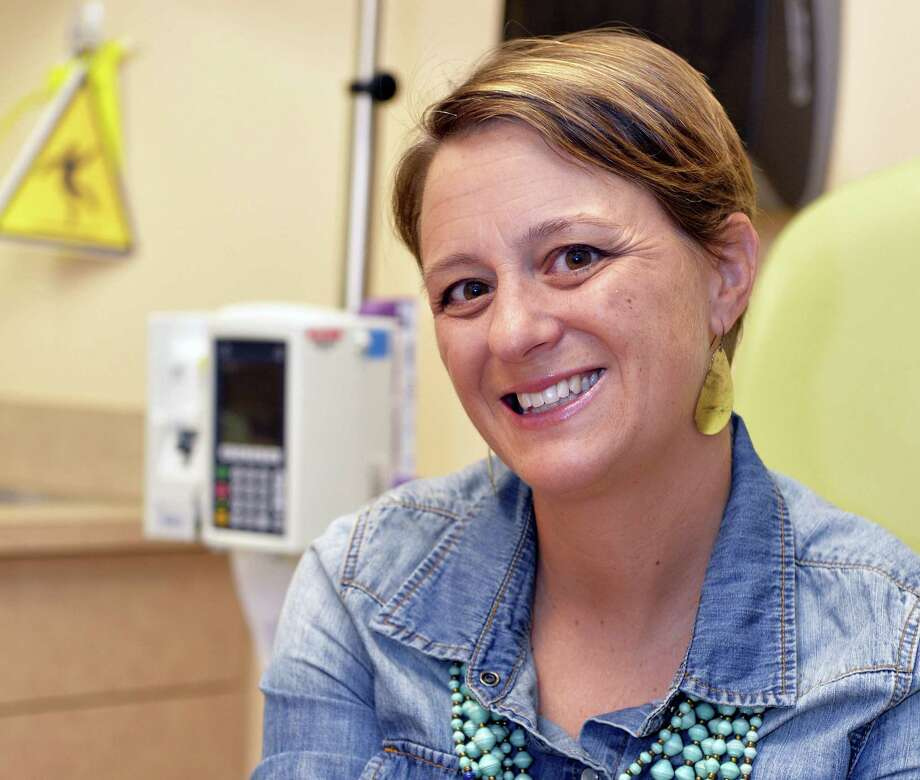 "Lara MacGregor, a participant in a new crowdsourcing project for metastatic breast cancer research, poses for a photo as she undergoes treatment at the Norton Cancer Center in Louisville, Ky. on Sept. 21, 2016. In just the first year, more than 2,600 affected patients have enrolled in the project, submitting samples and medical records by mail. ""I hope that real data about real people is going lead to better treatment options,"" she says. ""My life depends on it."" Photo: AP Photo/Timothy D. Easley   / FR43398 AP"