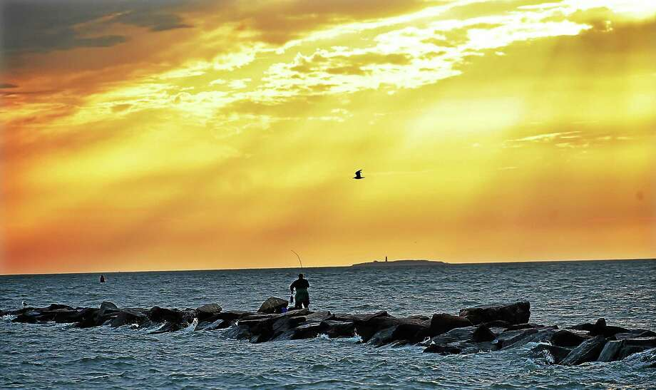 Rays of sun poke through the sky at Meigs Point, Hammonnasset Beach State Park, in Madison, in this 2015 photo. Photo: New Haven Register File Photo   / New Haven RegisterThe Middletown Press