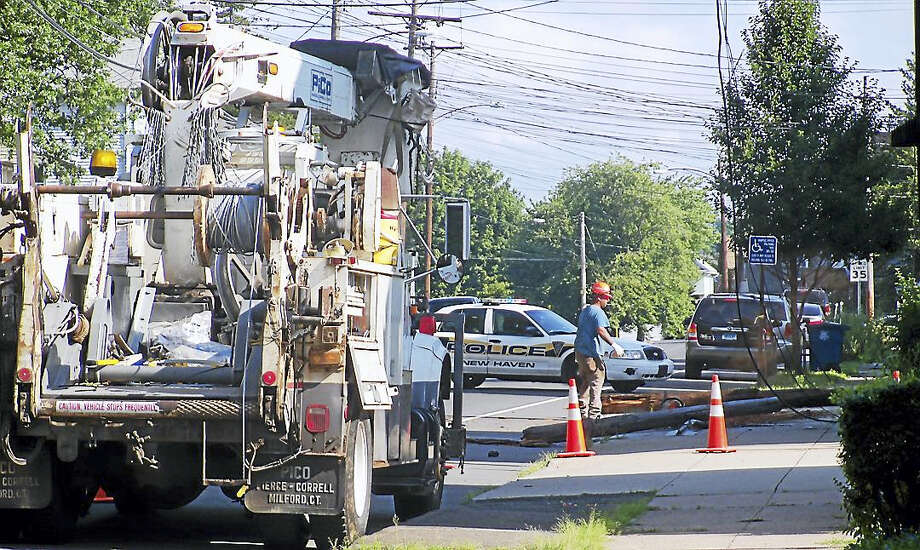 Part of State Street was shut down for about an hour Monday morning near the New Haven-Hamden line after a crash that took out a utility pole and wires. Photo: (Wes Duplantier/The New Haven Register)