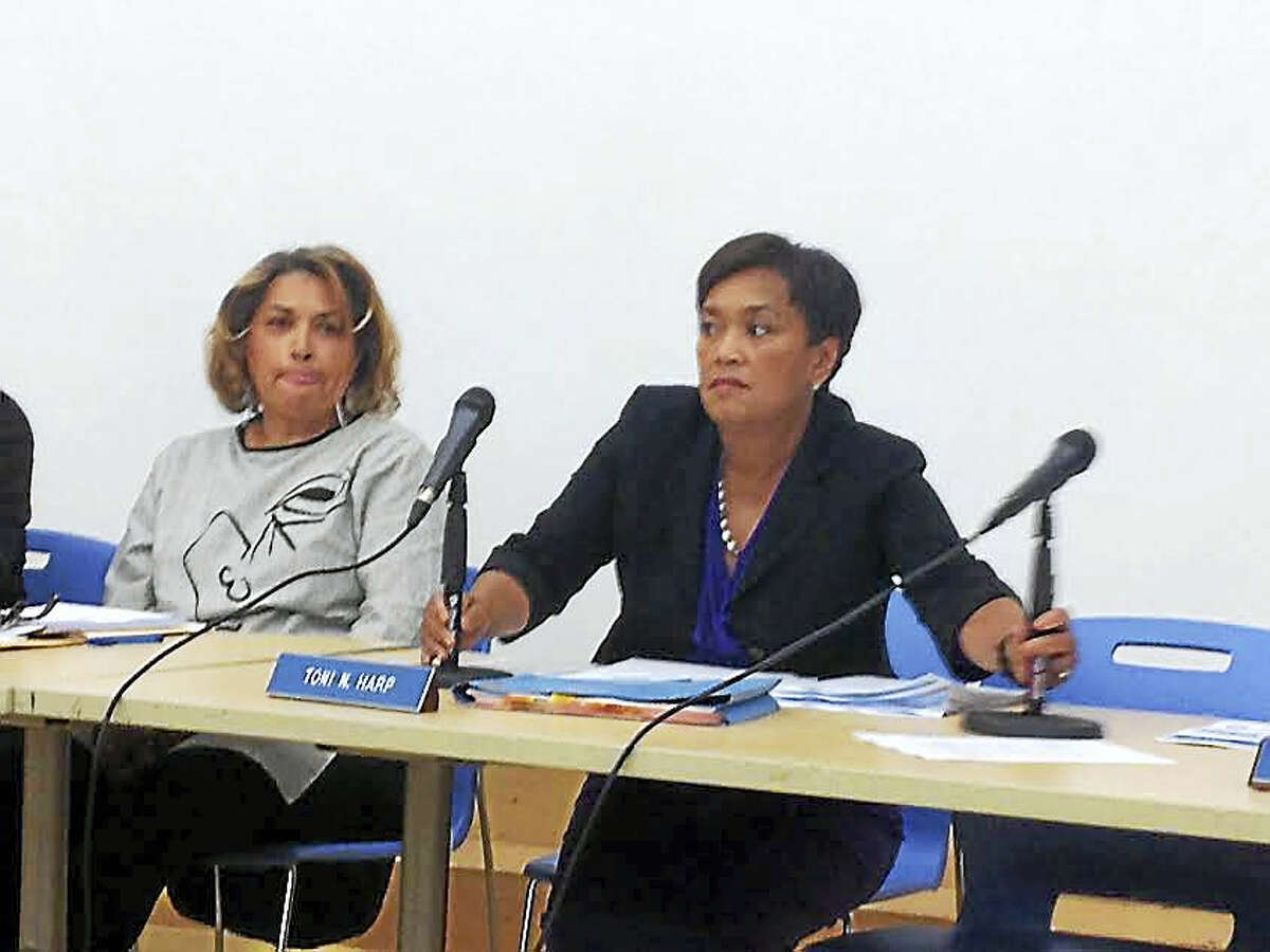 Mayor Toni Harp, right, and Alicia Caraballo before a September meeting of the Board of Education.