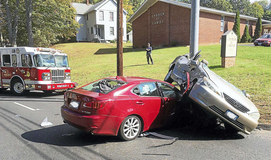 Part of Whitney Avenue was shut down for about an hour Monday morning near the Hamden-North Haven town line after a two-car crash. Three people were reportedly taken to the hospital. Photo: Photo Courtesy Of The Hamden Fire Department