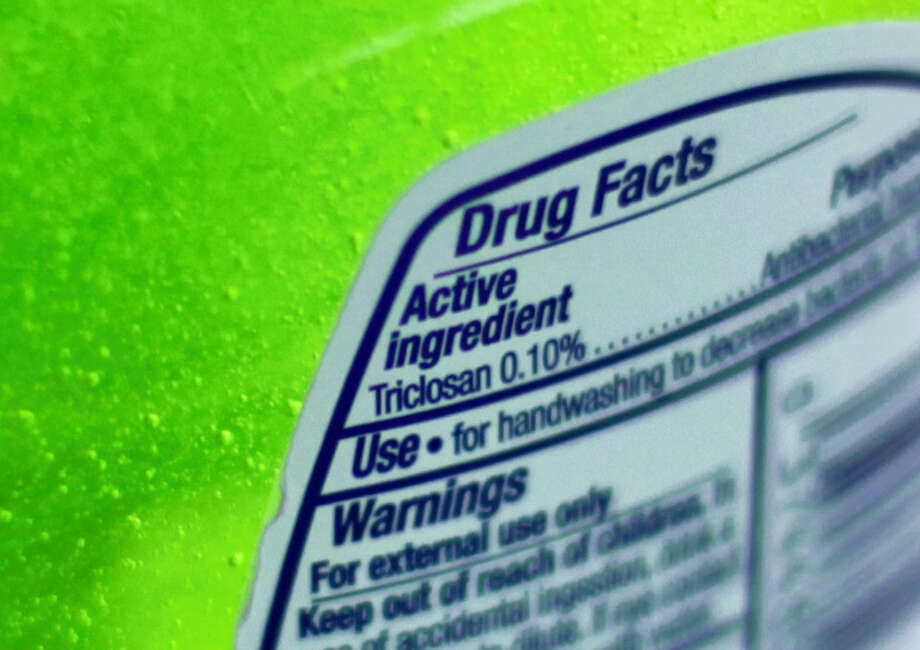 This Tuesday file photo shows the label of a bottle of antibacterial soap in a kitchen in Chicago. Photo: Kiichiro Sato — The Associated Press   / AP2013
