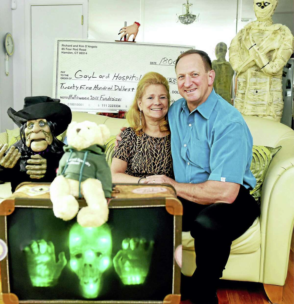 Kim D'Angelo with her husband, Richard, at their Hamden home Monday. Kim D'Angelo was a patient at Gaylord Hospital and has been fundraising for Gaylord by staging Halloween parties.