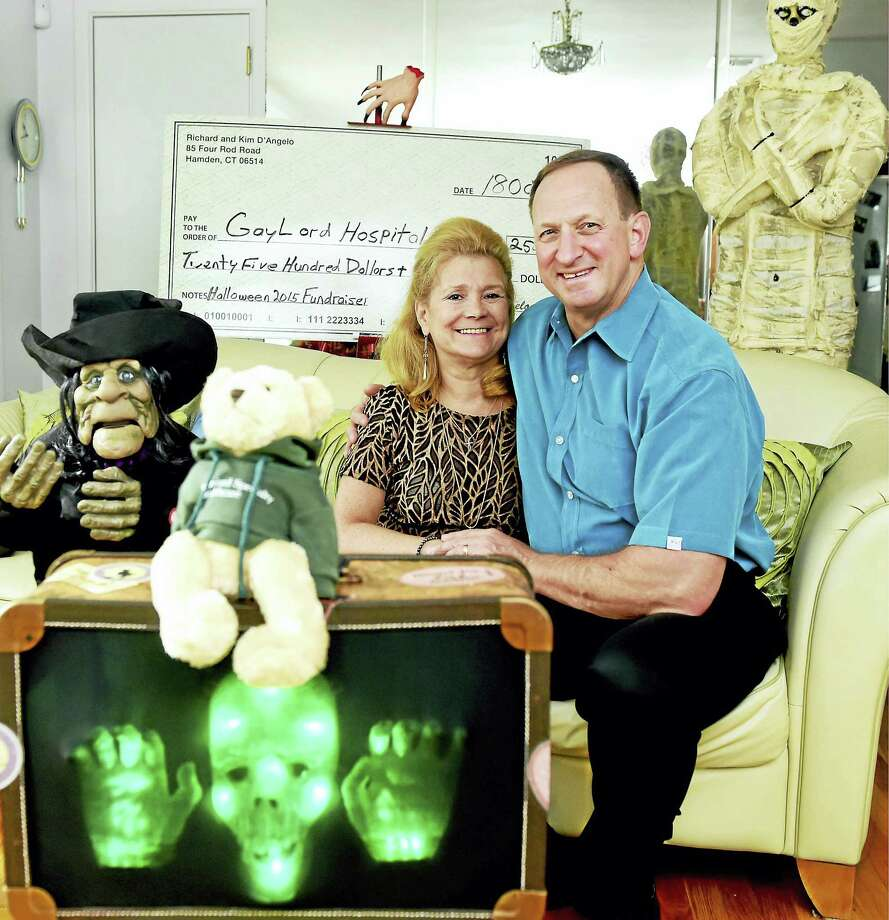 Kim D'Angelo with her husband, Richard, at their Hamden home Monday. Kim D'Angelo was a patient at Gaylord Hospital and has been fundraising for Gaylord by staging Halloween parties. Photo: Peter Hvizdak — New Haven Register   / ©2016 Peter Hvizdak